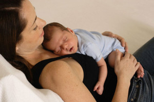 Mother with Son Sleeping on Her Chest --- Image by © David Raymer/Corbis